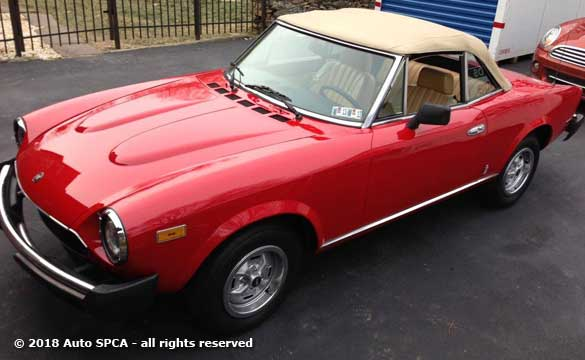 Drivers Quarter view of our 1980 Fiat 124 Sport Convertible